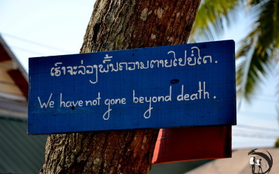 Laos. Buddhist sign post